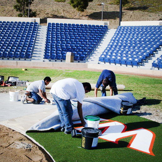 SECURING TURF WITH ADHESIVE